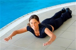 woman exercising on stomach